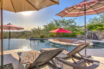 Short walk to back yard and infinity edge pool (heating optional) with waterfall and magnificent views of Phoenix