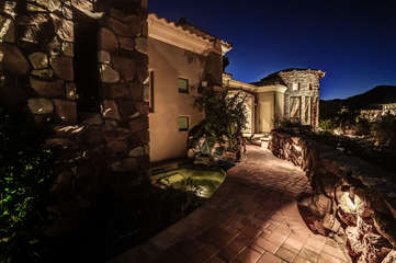 Exquisite night view of front courtyard and entrance to home and Safari Casita