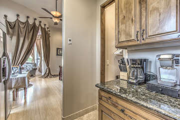 Kitchen is centered between bedroom and bath and has entrance to walk-in closet