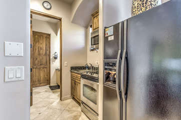 Stainless steel appliances and granite counter tops add to luxurious feel of casita