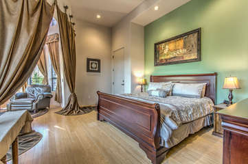 Accommodations include a deluxe king bed with mountain views
