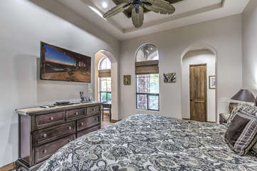 Bedroom is large with trey ceilings and beautiful tile floors