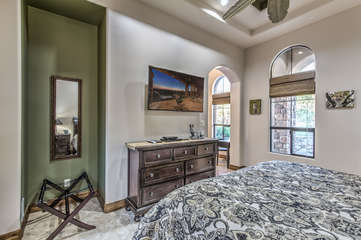 Stylish bedroom is spacious and has storage space for personal items