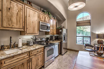 Kitchen includes full size appliances, granite counter tops and impressive mountain view