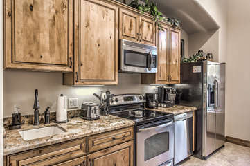 Completely stocked kitchen is ready for you to prepare and serve your favorite cuisine