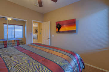 Third bedroom has king bed for sleeping or watching your favorite golf game in peaceful setting