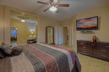 Master suite has walk-in closet, ensuite bath, large TV and sitting area with queen sleeper sofa