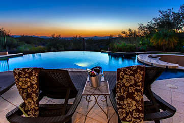 Watch the city lights come alive with each sunset from your own private resort