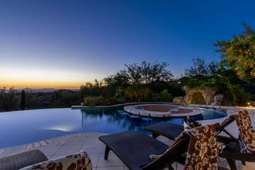 Infinity edge pool with guest option to heat offers exotic views of Phoenix and the mountains