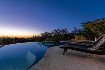 Infinity edge pool with guest option to heat offers exotic views of Phoenix and mountains