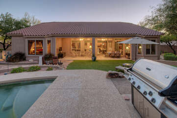 Outdoor amenities include pool, hot tub, large gas grill, wood burning fire pit, corn hole game, portable TV, electric putting game with 2 putters, outdoor heaters and many trees that offer shady spots to relax