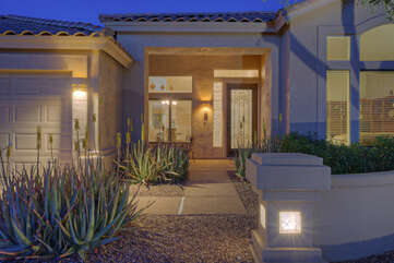 Professionally landscaped entrance welcomes you to well appointed 5 BR, 3 BA home
