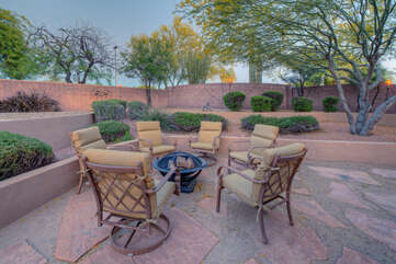 Gather around the wood burning fire pit with seating for 6 on a cool evening