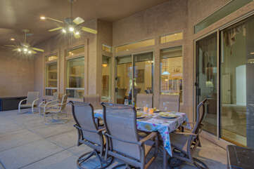 Covered porch with outlet for portable TV offers choice dining and relaxing opportunities