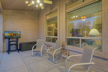 Gorgeous, large covered patio is ideal place to sip coffee and catch up on the news on portable indoor/outdoor TV