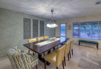 Table seating with a view of the back yard for formal dining and special occasions