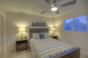 Fourth bedroom also has a queen bed, ceiling fan and television