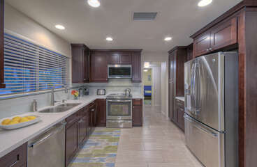 Gleaming kitchen features stainless steel appliances and granite counter tops