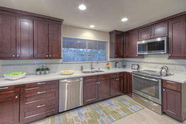 Bright and cheerful kitchen with back yard view will make the chef and helpers happy