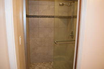 Walk-in tiled master bathroom shower