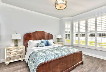 Master Bedroom with King Bed and Flat Screen TV; Private Entrance to Lanai Area; New Window Treatments!