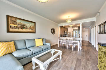Living Room with Brand New Furniture and Flat Screen HDTV; Entrance to Lanai Area with Golf and Lake Views; Totally Redecorated in 2016! Blue Couch is a Pullout!