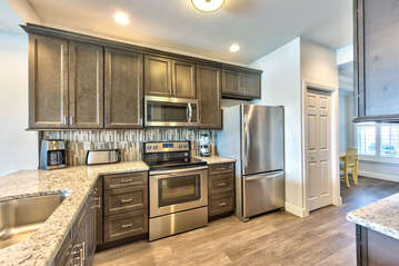 Fully Stocked Kitchen with Luxury Appliances; Granite Counter-tops and New Cabinetry! Totally Refurbished in 2016!