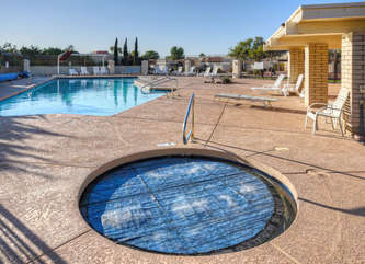 Walk to sparkling heated community pool and hot tub for a warm splash