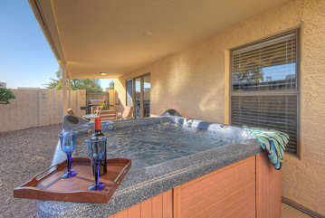 Cheers to romantic moments in private hot tub on covered patio