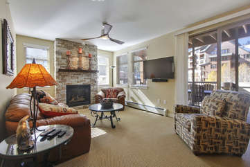 Living Room with Fireplace and custom wall-mounted 55