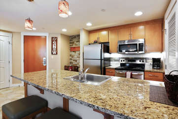Kitchen with large counter bar