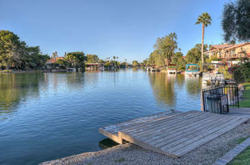 Walk past 3 homes to access a dock and the larger part of Tempe Lake