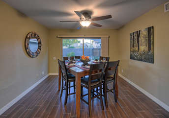 Home is bright and cheerful with exciting views of pool and lake from many windows and doors