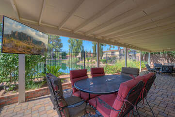 Expansive covered patio is furnished for the ultimate relaxing, dining and viewing experiences