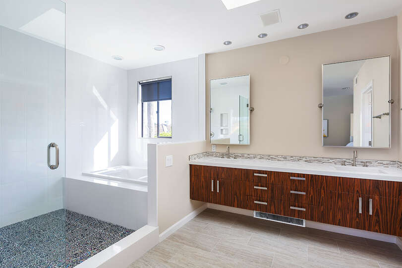 Bathroom 2 includes double sinks and spacious shower