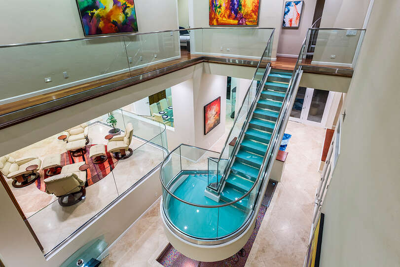 Architectural highlight of this magnificent villa is the spectacular glass staircase