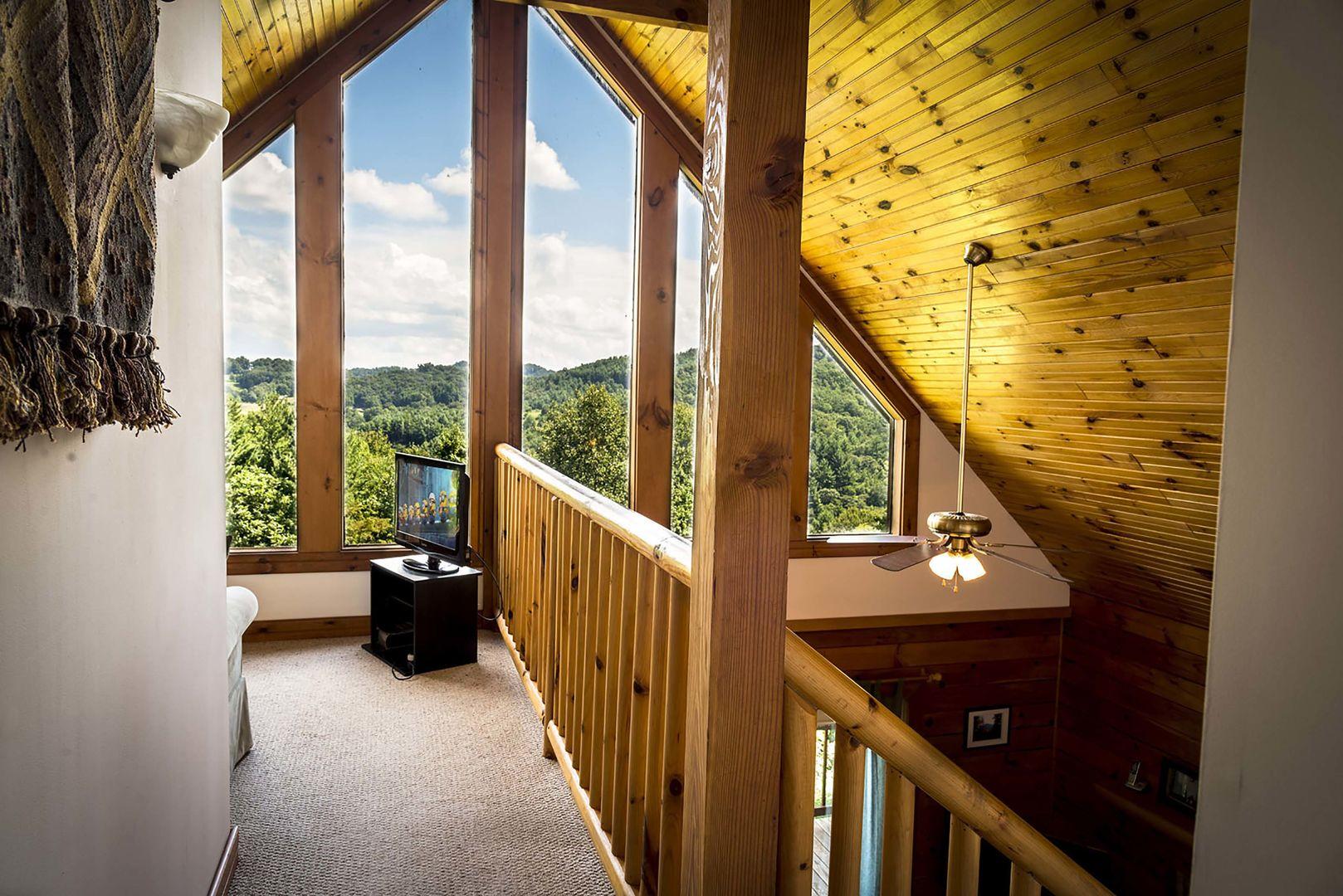 Upstairs loft with triangular windows