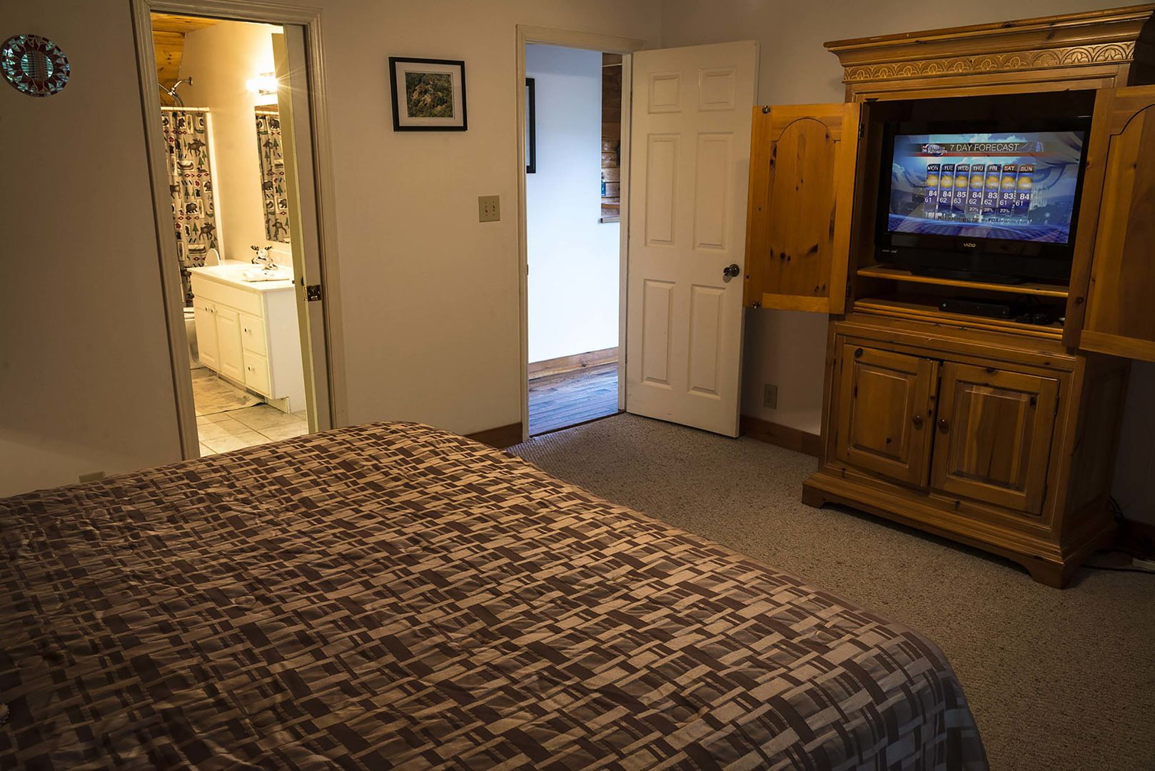 Main level master bedroom with a king bed and access to the bathroom
