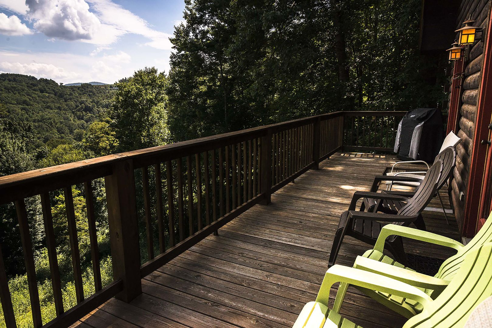 Deck with chairs facing the mountains