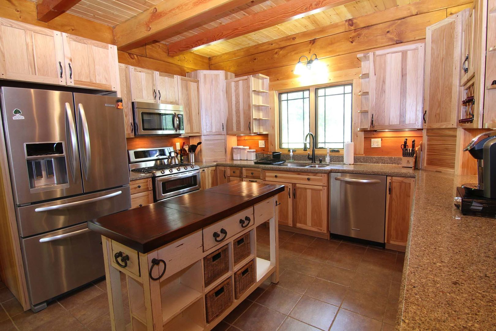 Well-equipped kitchen with butcher block island