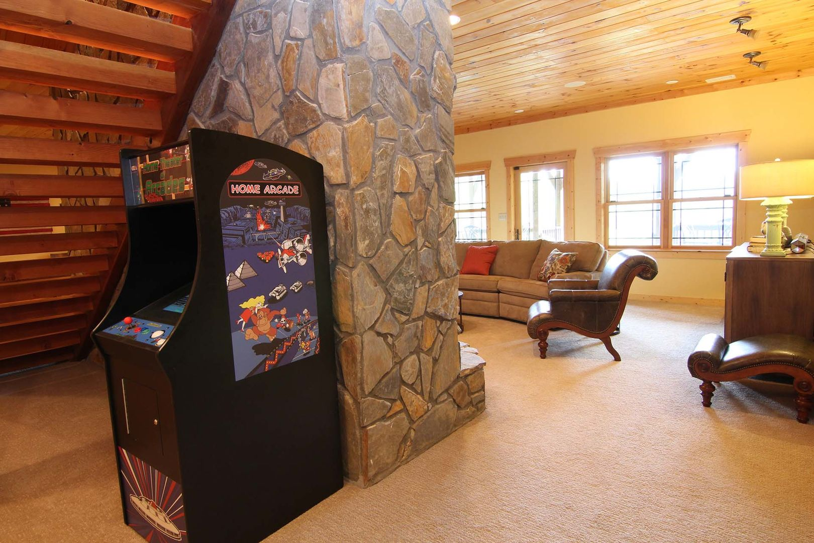 Downstairs living area with arcade game
