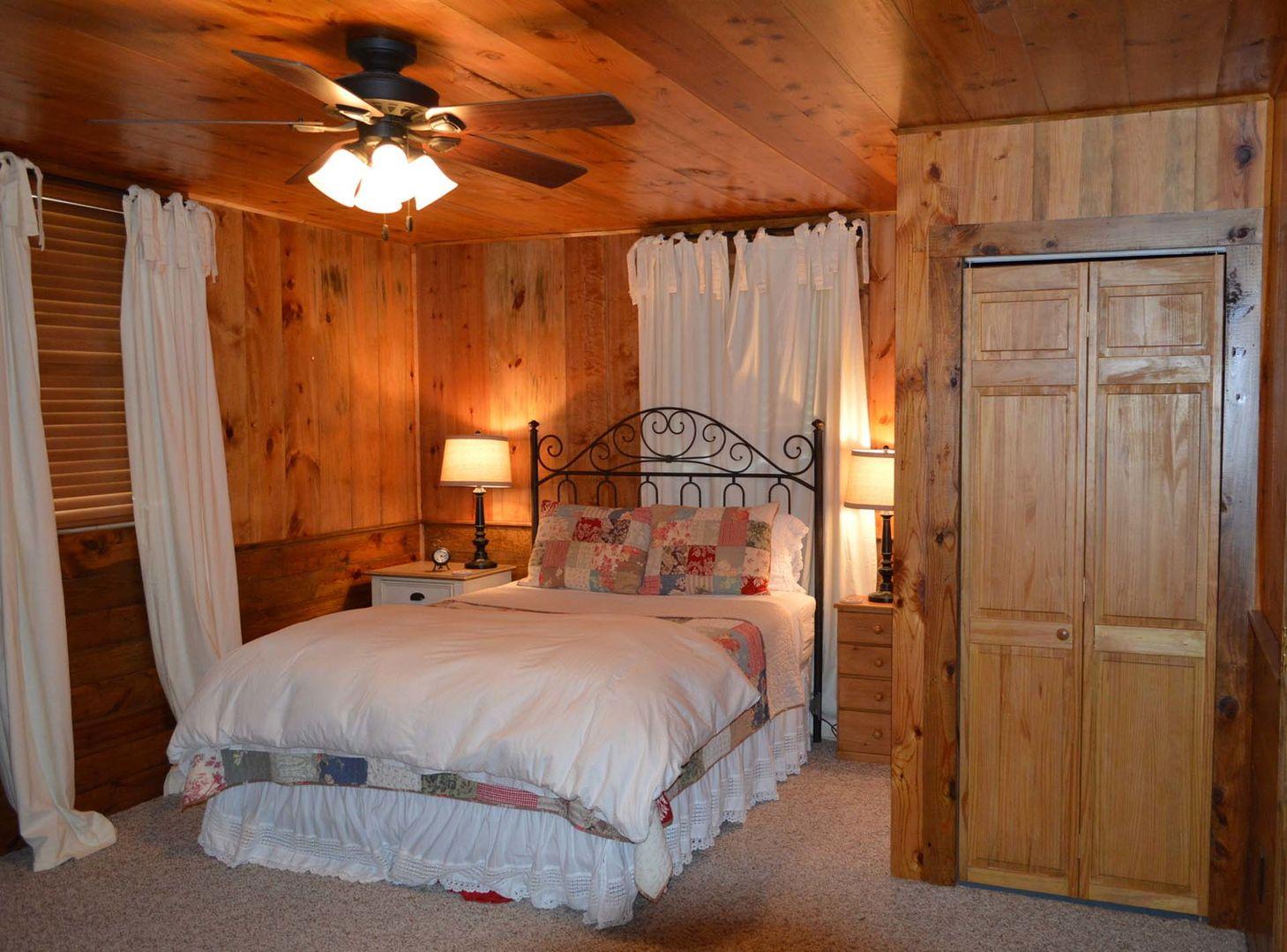 Bedroom downstairs with queen bed