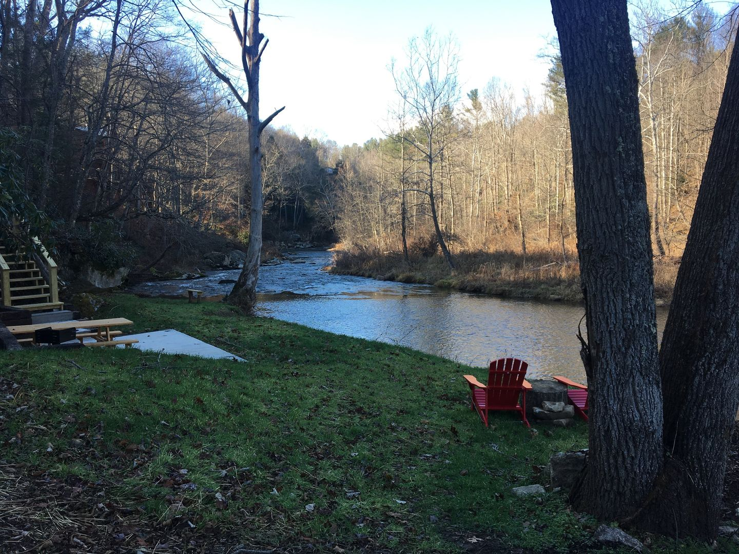 Area near river with table and chairs