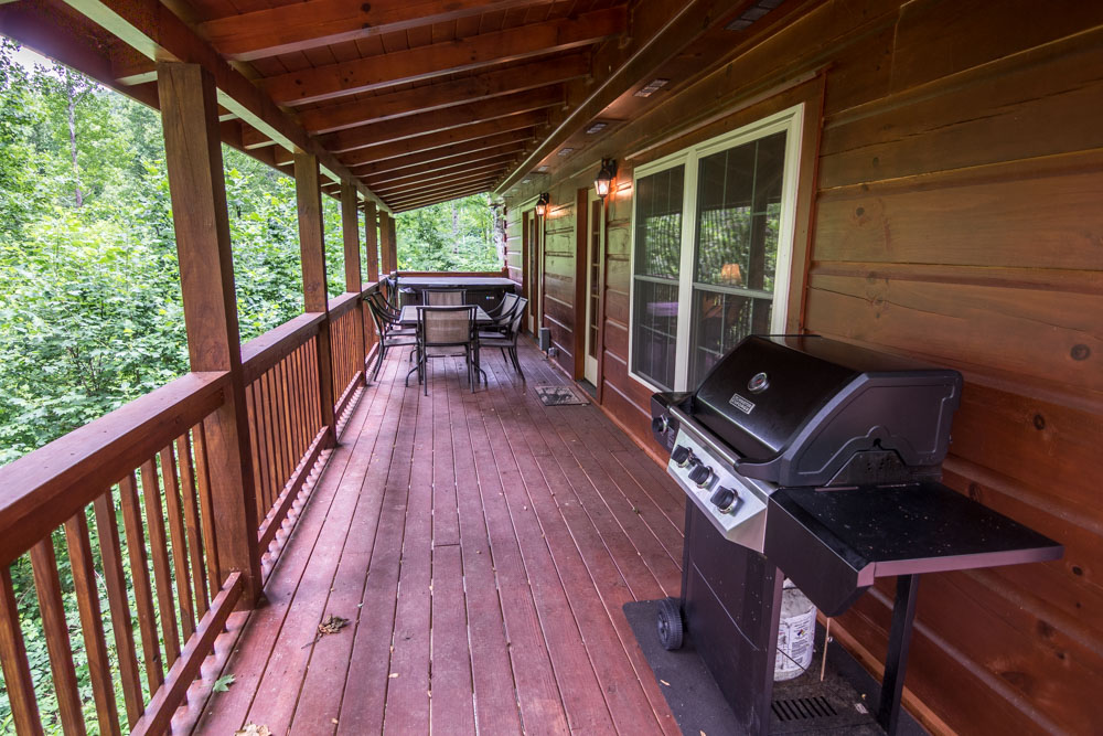 Back deck with table, chairs and a grill