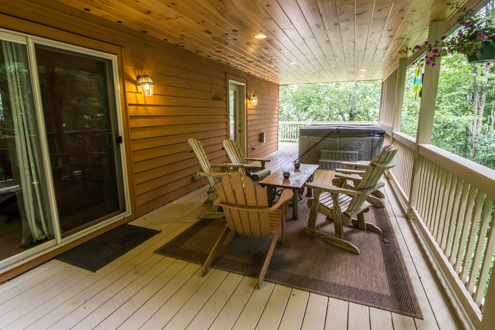 Lower deck with table, chairs and hot tub