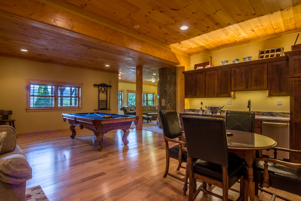 Downstairs living area with pool table