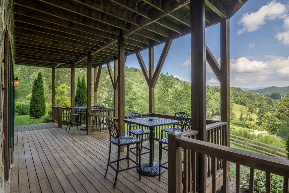 Deck with table, chairs and mountain views
