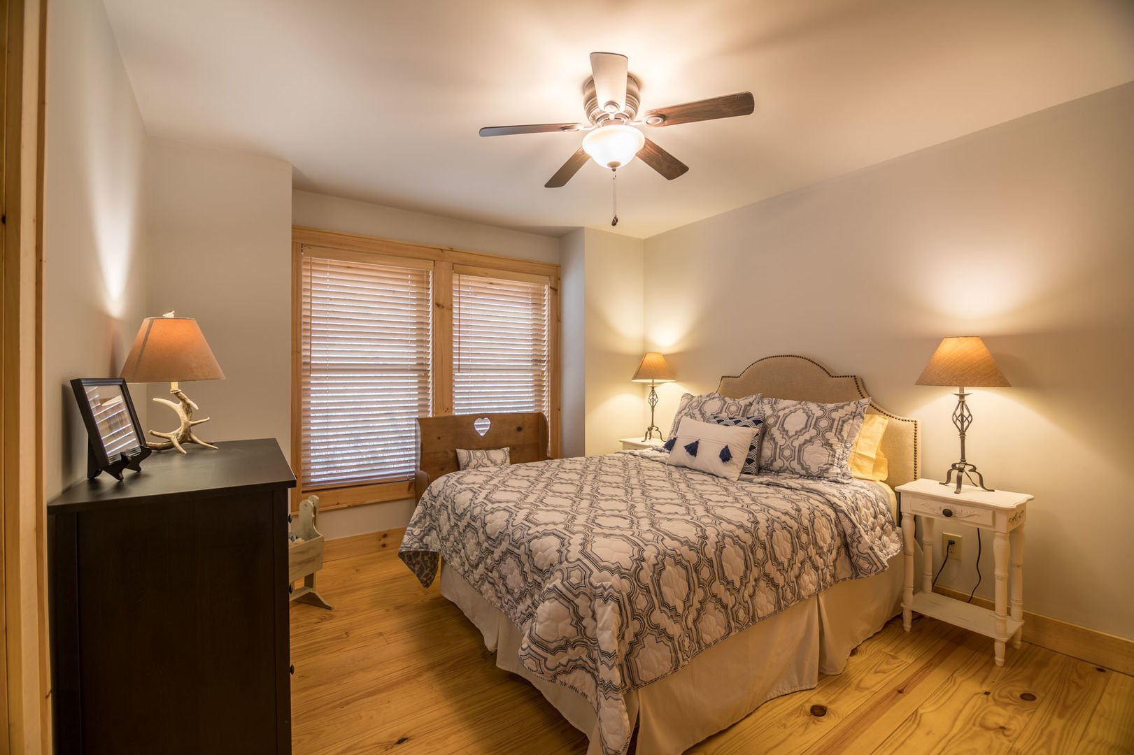 Master bedroom with king sized bed and full bathroom