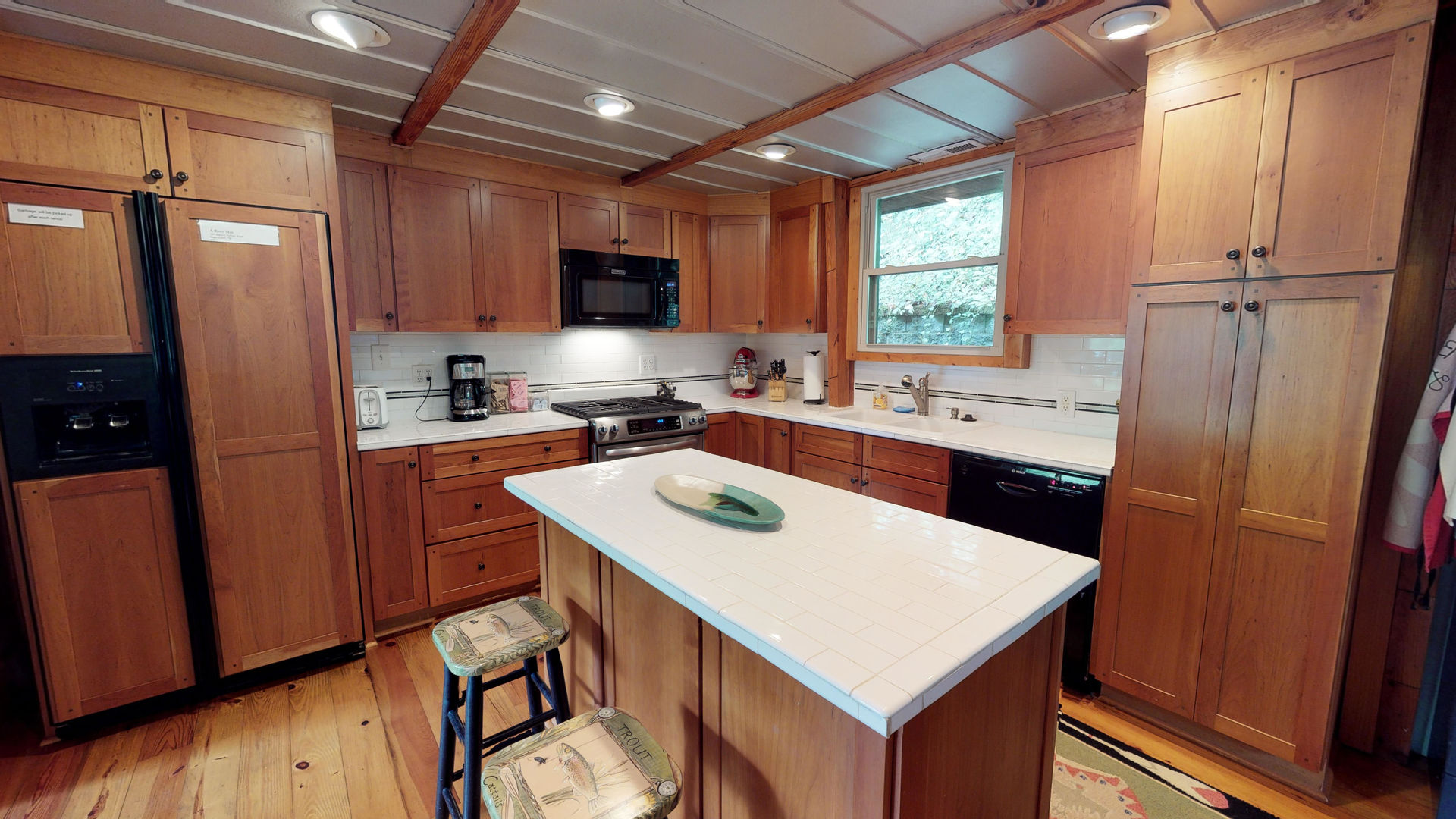 Kitchen with island seating for 2