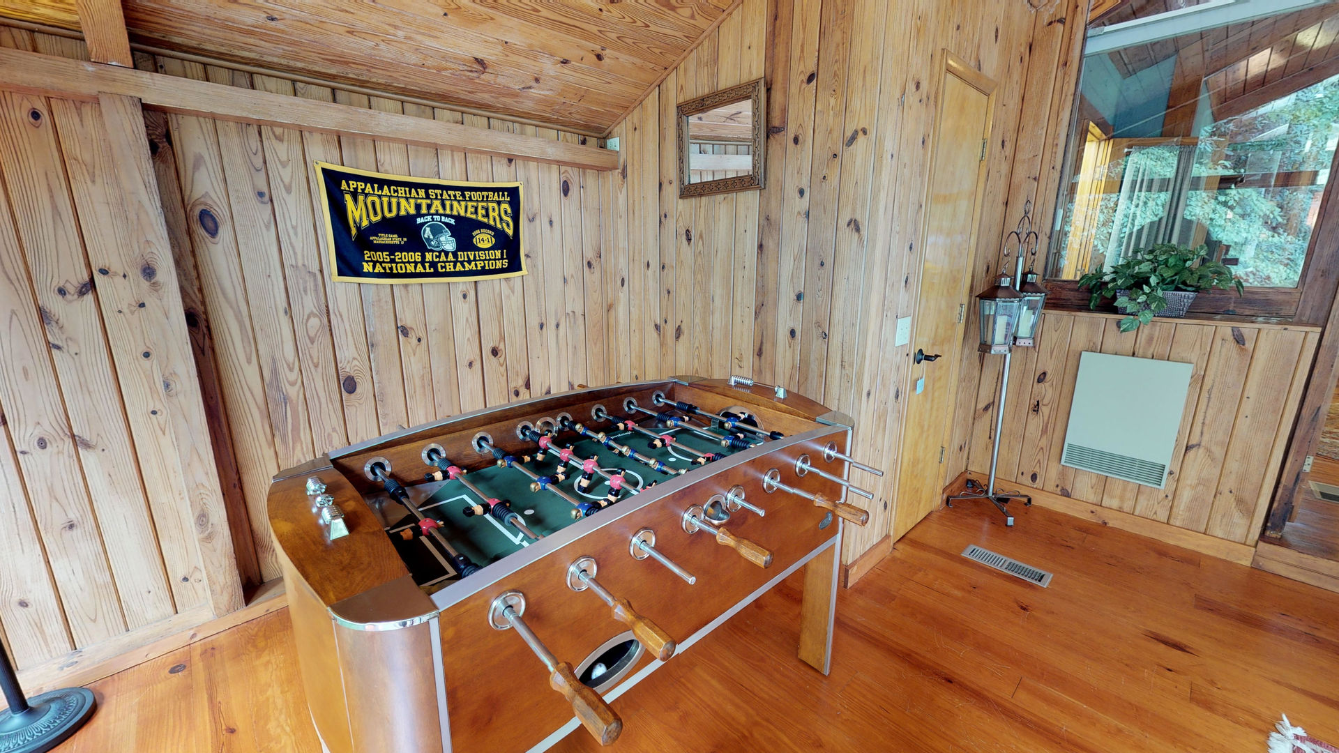 Upper level game/sitting room with Foosball table